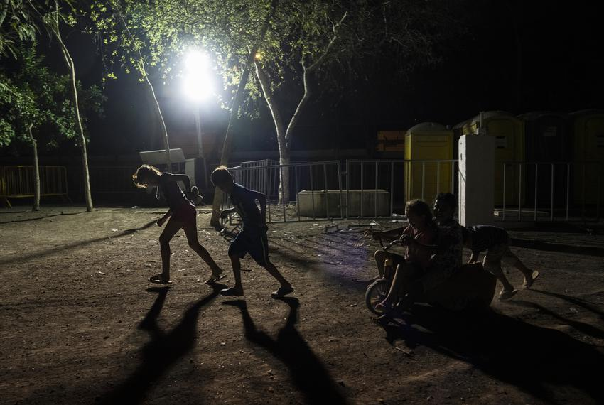 Asylum-seeking children play at a migrant camp in Matamoros, Mexico on May 15, 2020.