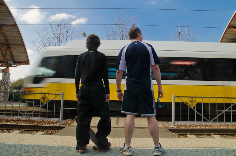 James and his adoptive son wait to board the DART train in Dallas on January 30, 2011. The son, who is 15, is on a state registry of people who abuse children.