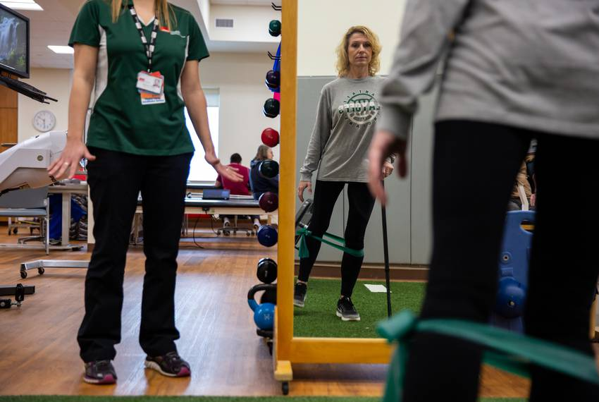 Flo Rice works out her legs by using resistance bands in a balance and hip strengthening exercise. Having been shot in bot...