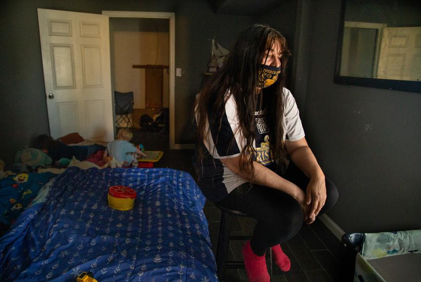 Lucille Hammash rests for a moment while her two grandson's play behind her in their home in central Houston, on April 11, 2…