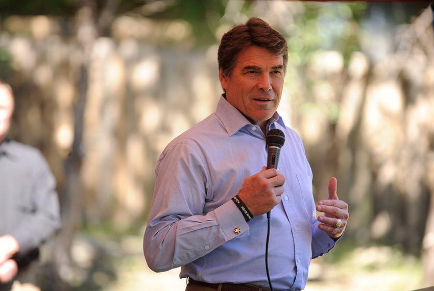 "Gov. Rick Perry, speaks at the site in Jonestown, Texas, where volunteers will build a home for injured war veteran Augustine ""Augie"" Pena."
