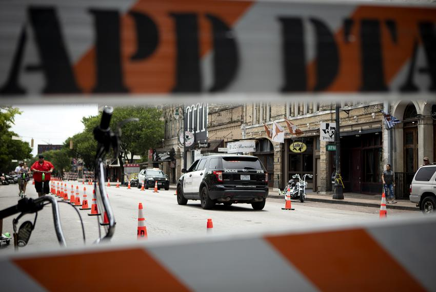 Austin Police patrol the site of a recent mass shooting. At least 13 people were injured in a shooting on East Sixth Street …