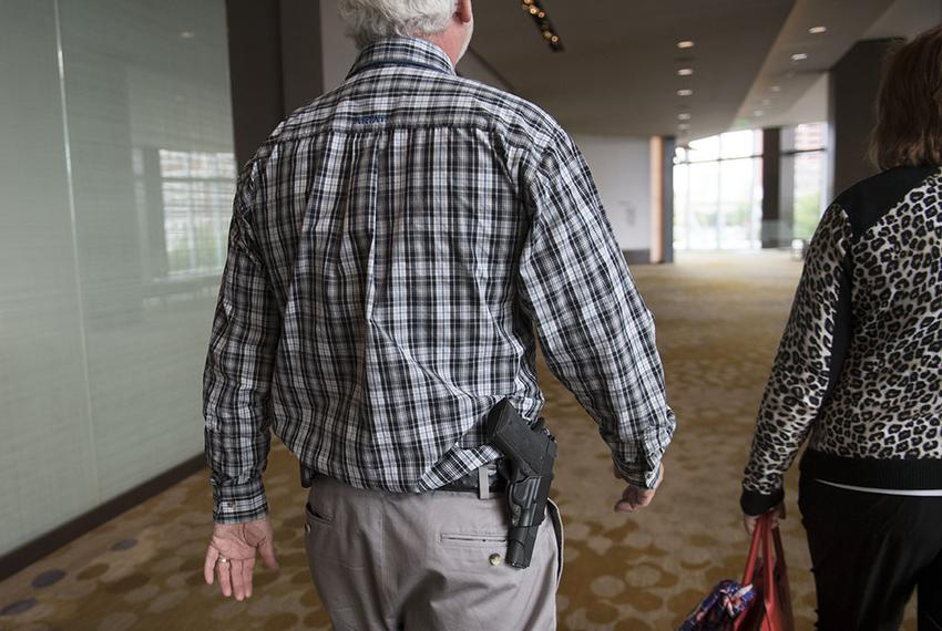 Delegate James Blair of Cherokee County open carries a firearm while leaving the Dallas Convention Center at the Republica...