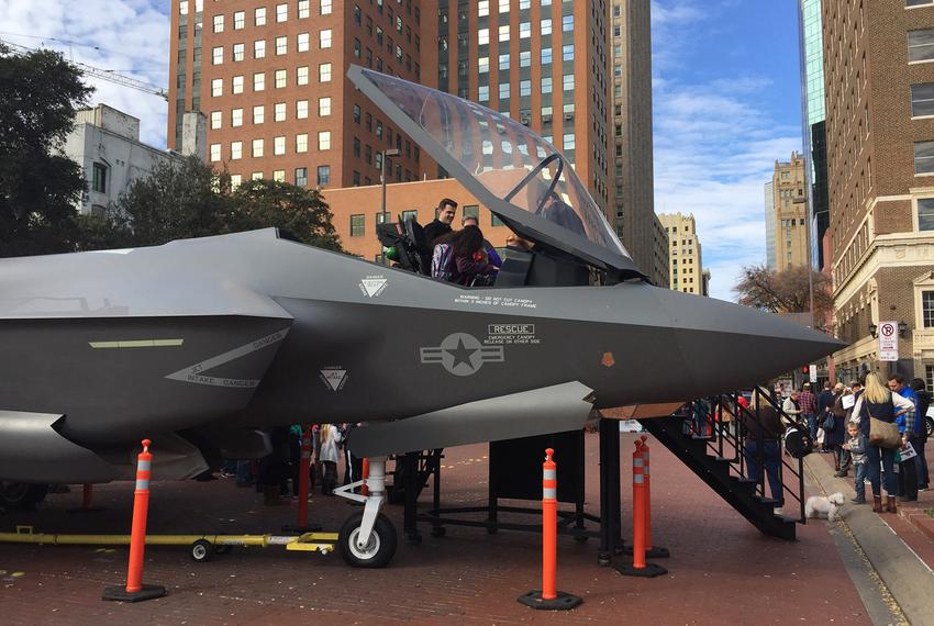 Fort Worth residents posed for photos on Dec. 21, 2016, with a model of the F-35 fighter plane, which is manufactured at a...