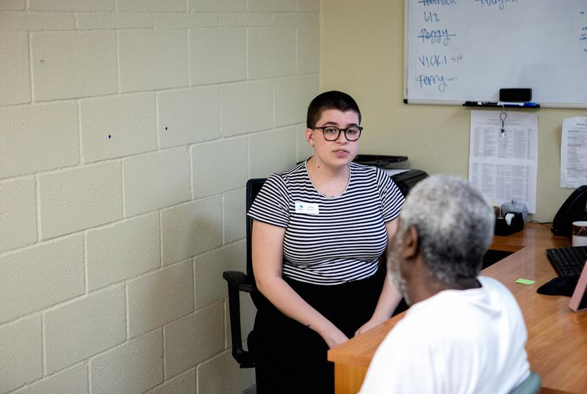 Hope Beaver, a complex needs case manager at Austin Street Center, speaks with an elderly client who needs to visit the Soci…