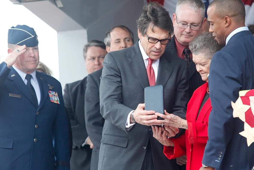 Governor Rick Perry and state representative Scott Turner, right, present Nadine Murphy, sister of the late Audie Murphy, wi…