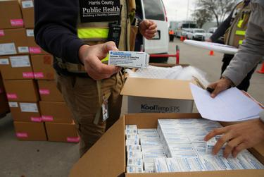 Harris County Public Health workers received 12,000 doses of the new Johnson & Johnson coronavirus vaccine at NRG Stadium in Houston on March 2, 2021.
