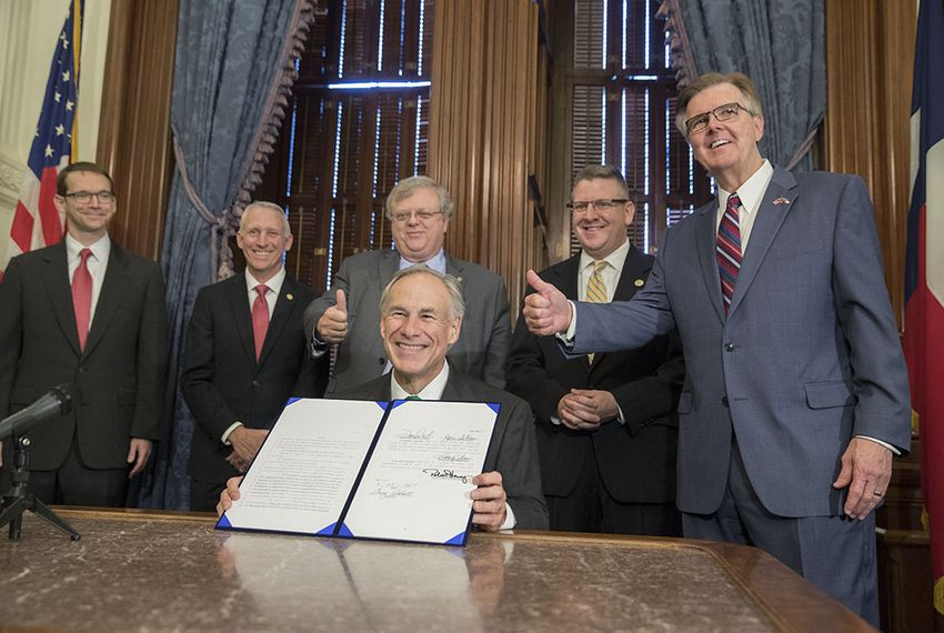 After signing it into law on May 25, Gov. Greg Abbott displays Senate Bill 7, which toughens the penalties for inappropriate student-teacher relationships. In the background: Texas Education Agency Commissioner Mike Morath, State Rep. Gary VanDeaver, R-New Boston, Sen. Paul Bettencourt, R-Houston, State Rep. Tony Dale, R-Cedar Park and Lt. Gov. Dan Patrick.