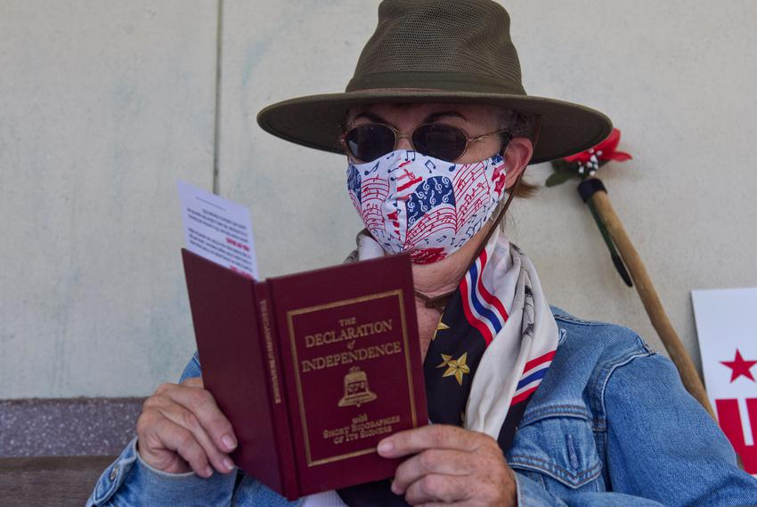 Rebecca Whittaker-Enzinger reads along with others at the annual Fourth of July reading of the Declaration of Independence a…