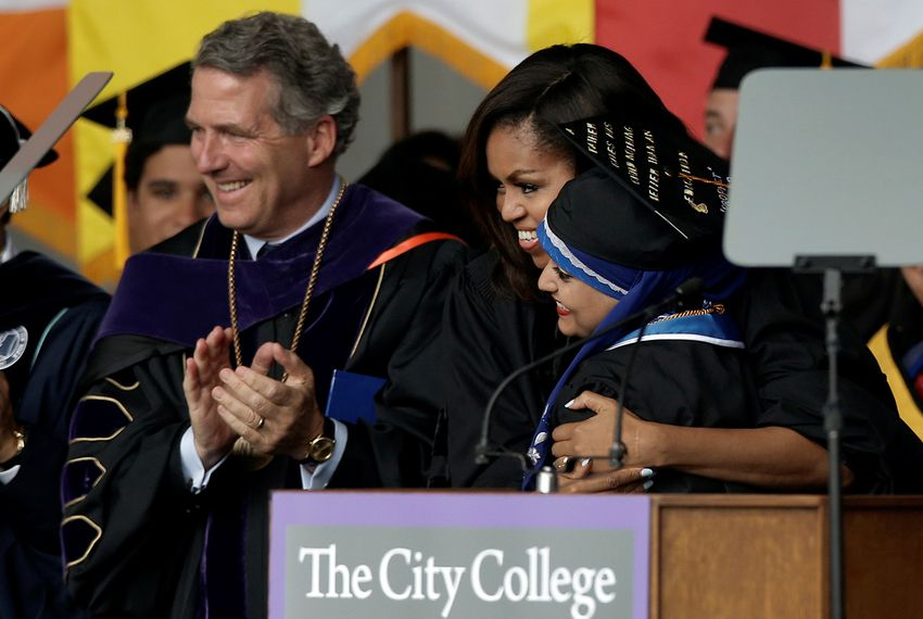 James B. Milliken, newly-named sole finalist for chancellor of the University of Texas System, at City College of New York's commencement ceremony with then-First Lady Michelle Obama and Salutatorian Orubba Almansouri, on June 3, 2016. Milliken was chancellor of CUNY at the time.
