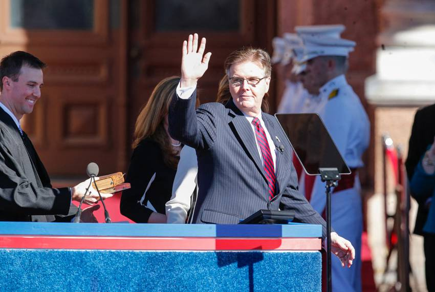 Patrick waves to the crowd before being sworn in.