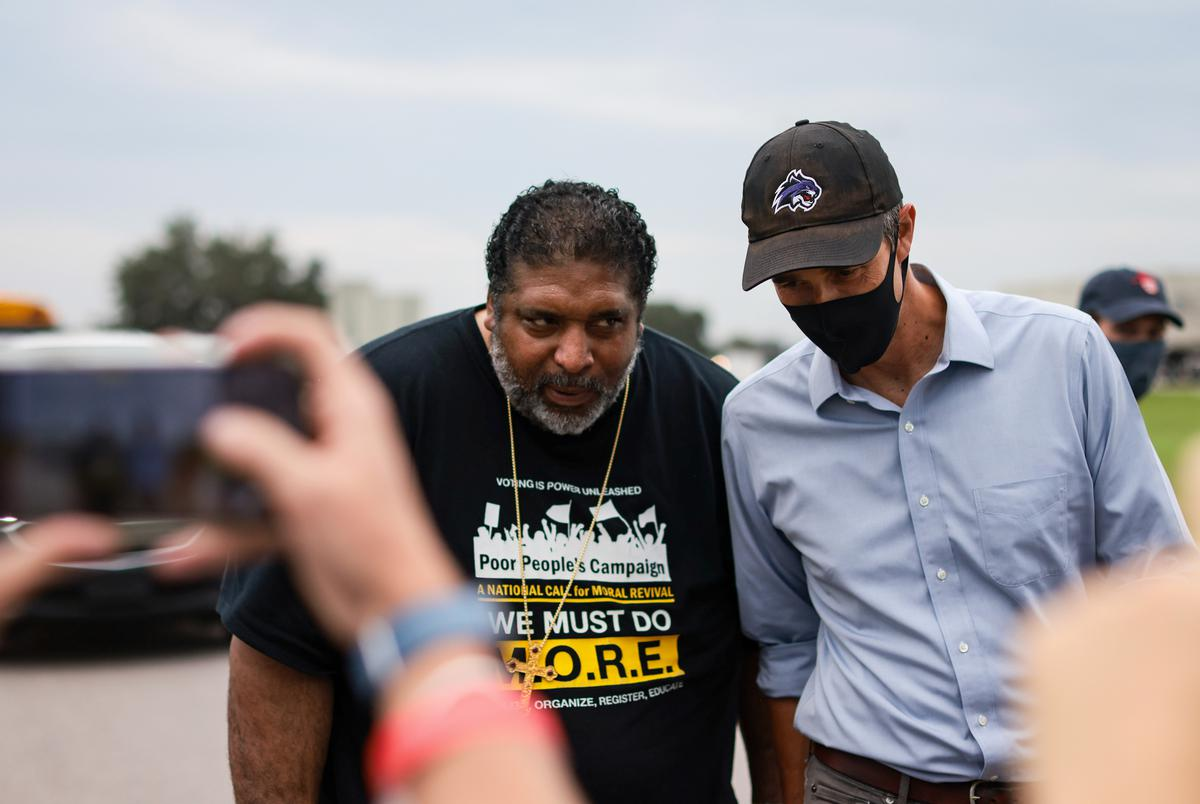 Rev. Dr. William J. Barber II, left, and former presidential candidate Beto O'Rourke, right, participate in the Georgetown-to-Austin March for Democracy on July 28, 2021.