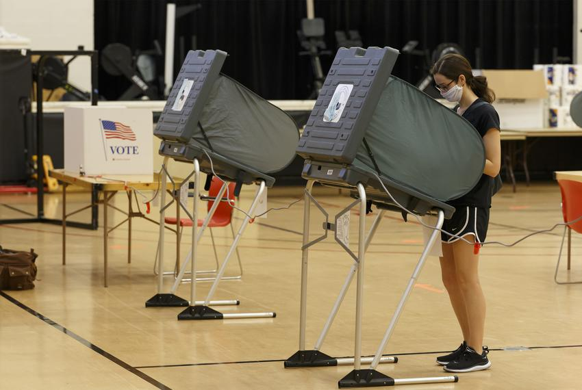 A voter casts her vote at the gymnasium at the Metropolitan Multi-Services Center in Houston for the delayed primary runoff …