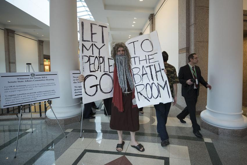 John Erler of Austin poses as Moses in the hallways of the Capitol Extension during public testimony on SB 6 the bathroom bi…