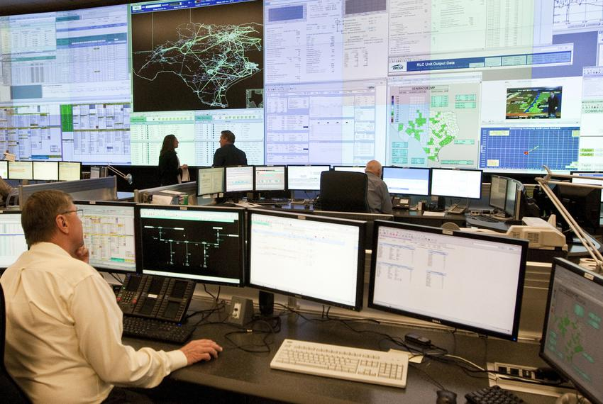 Grid technicians monitor screens at the Electric Reliability Council of Texas' state-of-the-art backup control center in Bas…
