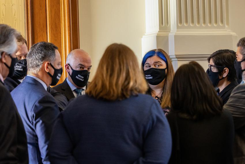 """A group of House democrats wearing masks with the slogan """"Good Trouble,"""" referencing the late civil rights leader John Lewis…"""