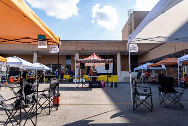 A DJ plays to a small crowd at a tailgate event for the University of Texas football home opener against UTEP on Sept. 12, 2020.