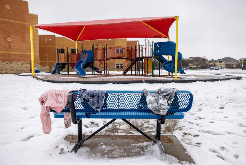 Frozen jackets sit on a bench at an elementary school in San Marcos as Texas continues to deal with sub-zero temperatures an…