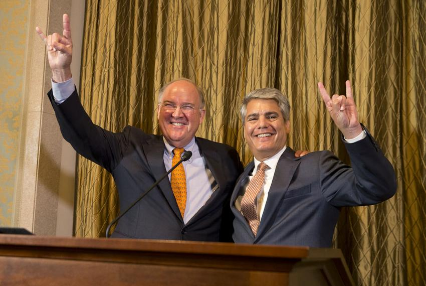 University of Texas at Austin President Gregory Fenves (right) introduced interim UT athletics director Mike Perrin on Sept.…