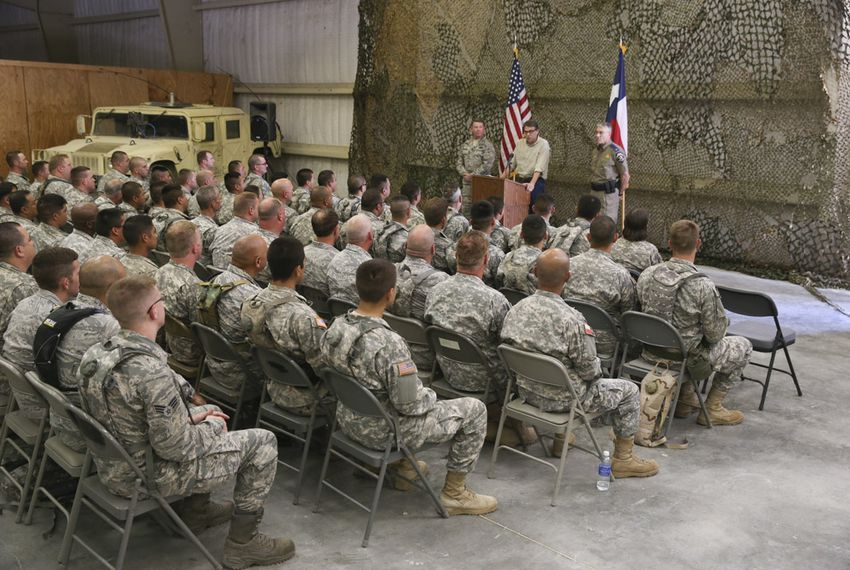 Governor Rick Perry gives a pep talk to National Guard troops training for deployment to the Texas border at Camp Swift on August 13, 2014.