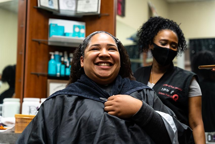 Avion Potter receives a hair relaxer treatment from hairdresser Aquita Gaddis. Gaddis reopened her hair salon after closin...