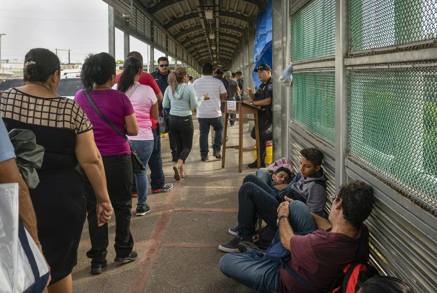 Asylum seekers from Central and South America wait on the Mexican side of the Brownsville/Gateway Bridge.