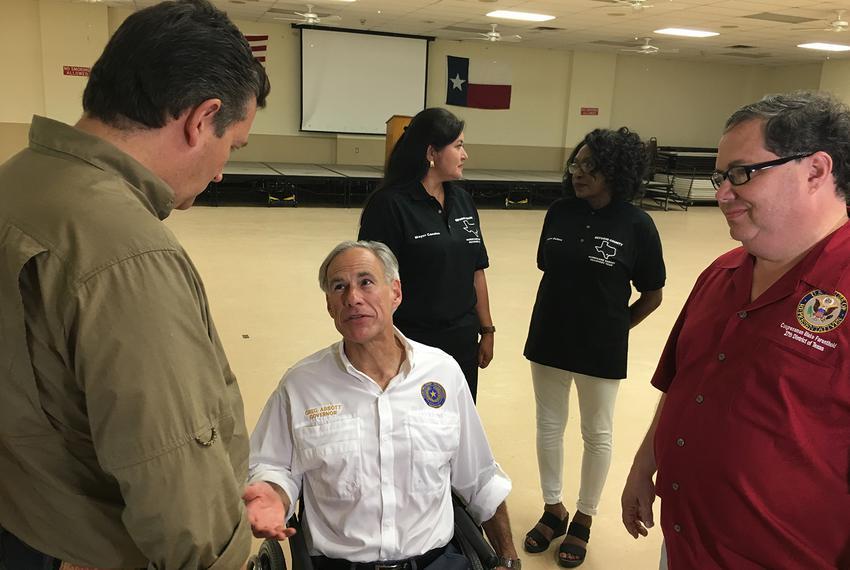 Gov. Greg Abbott speaks withU.S. Sen Ted Cruz (left) and Rep. Blake Farenthold, R-Corpus Christi, in Refugio on Oct. 9, 201…