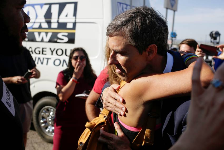 Democratic presidential candidate Beto O'Rourke embraces Patricia Olivera a relative of one of the survivors at the site o...