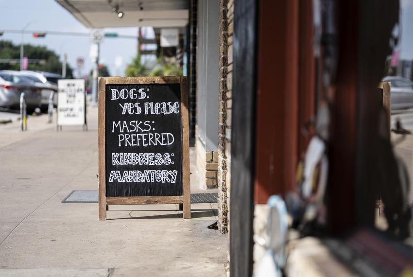 A sign at an Austin store tells patrons that masks are preferred on July 19, 2021.