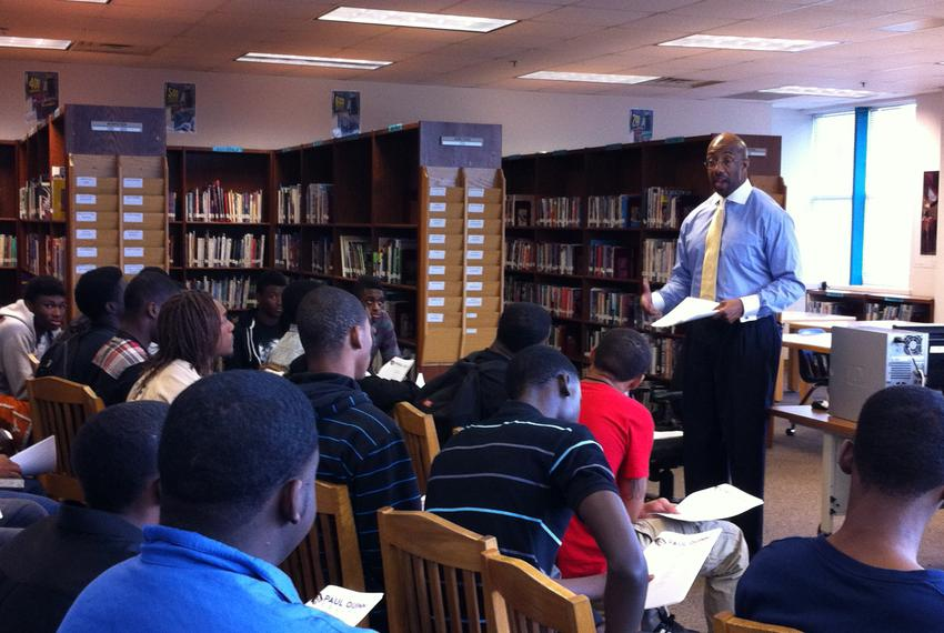 Paul Quinn College President Michael Sorrell addresses students in the school's library.