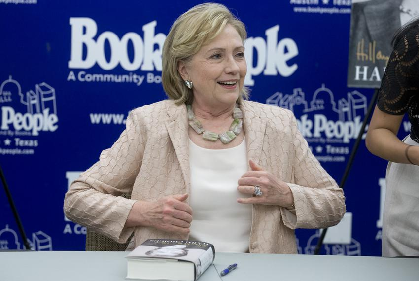Former Secretary of State Hillary Rodham Clinton readies for the onslaught of book patrons at BookPeople on June 20, 2014.