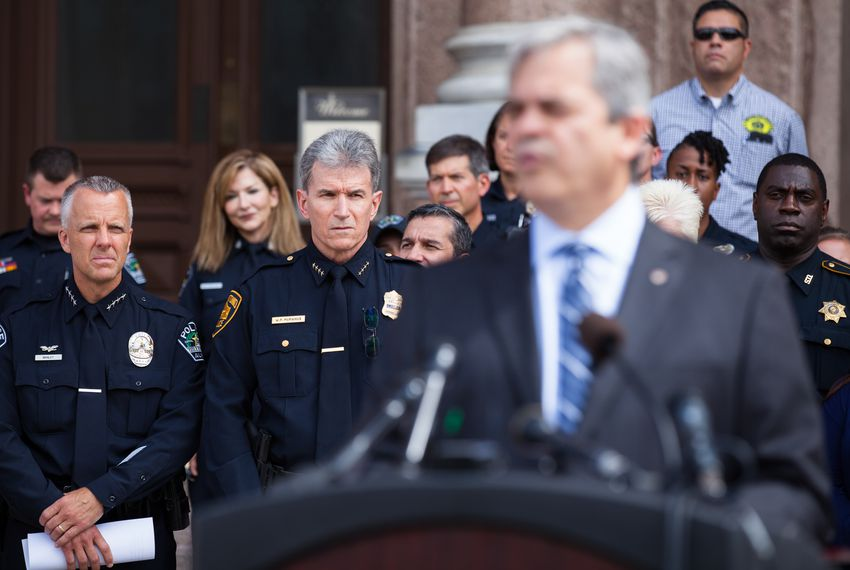 "Austin Police Chief Brian Manley and San Antonio Police Chief William McManus stand behind Austin Mayor Steve Adler on the steps of the state Capitol on July 25, 2017. Top Texas law enforcement officers gathered at the Capitol today to speak out against ""bathroom bill"" legislation."