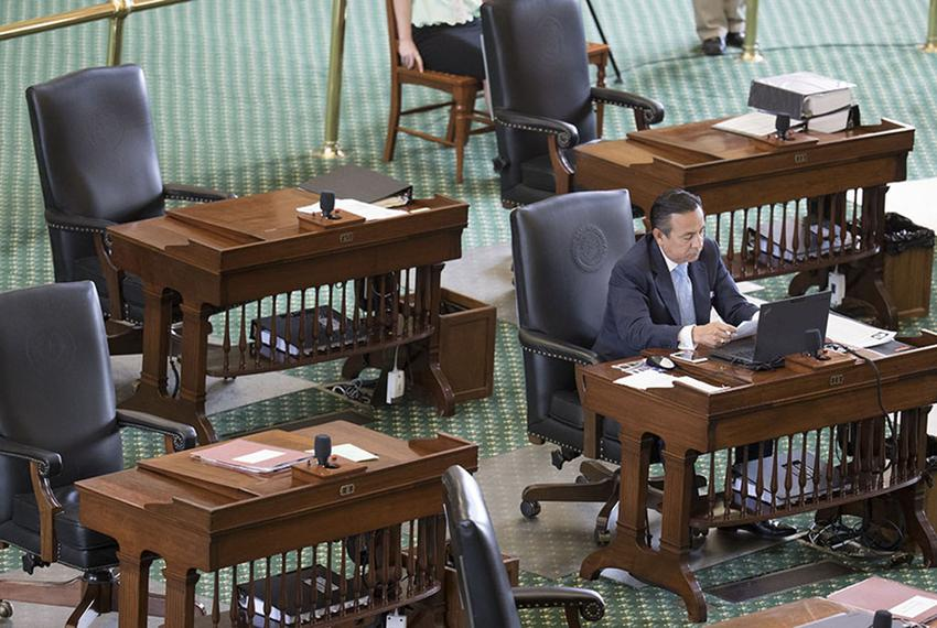 State Sen. Carlos Uresti, D-San Antonio, sits in a nearly empty Senate chamber for his Republican colleagues to return on Ju…