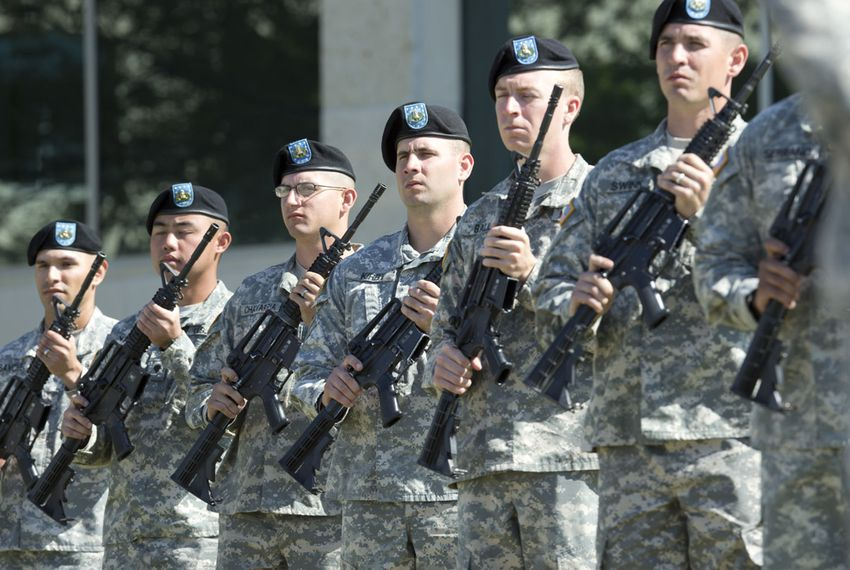 A military honor guard practices for Wednesday's memorial ceremony at Fort Hood ceremony on April 9, 2014.