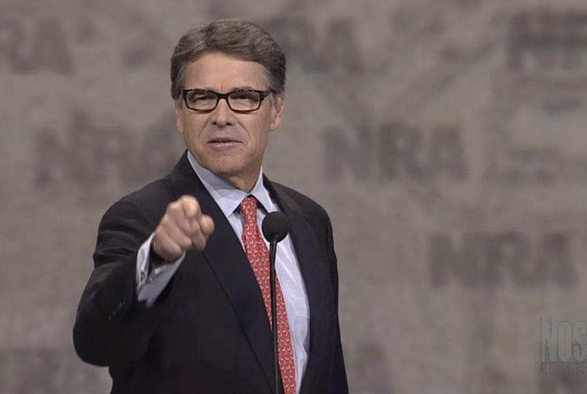 Former Gov. Rick Perry addresses the National Rifle Association's annual meeting Friday in Nashville. He used the speech t...