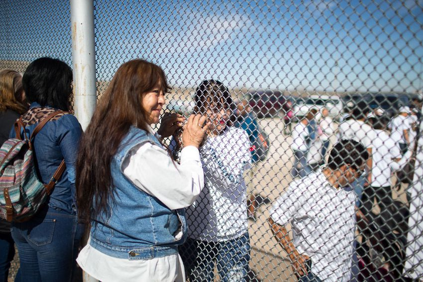 Maria Guadalupe Garcia Rodriguez of Juarez holds the hand of her daughter through the border fence in Juarez, Monday, February 15, 2016. She has not seen her daughter, Linda Rodriguez, since she was 6 months old.