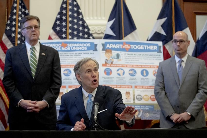 Gov. Greg Abbott, flanked by Lt. Gov. Dan Patrick, left, and House Speaker Dennis Bonnen, speaks during a press conference a…