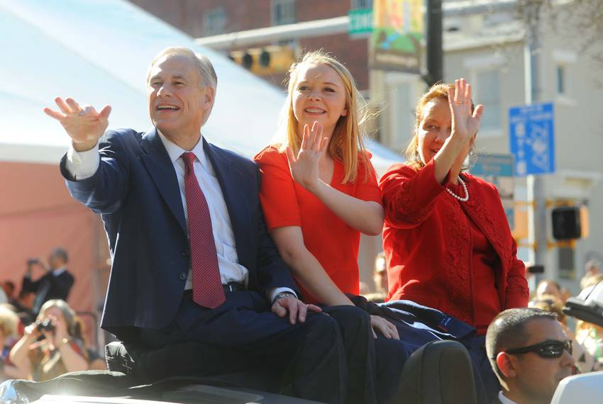 Abbott, his daughter Audrey and his wife, Cecilia, wave to folks at the inaugural parade.