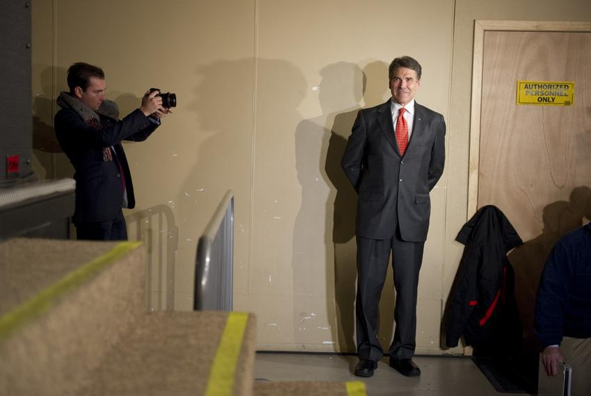 Gov. Rick Perry waits to go on stage at the 7 Flags Events Center in Clive, Iowa, on Jan. 3, 2012. Perry placed fifth in the…
