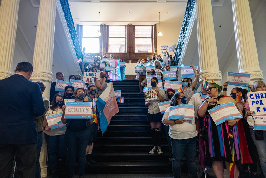 Transgender rights activists gather outside the entrance to the House floor in Austin on May 23, 2021.