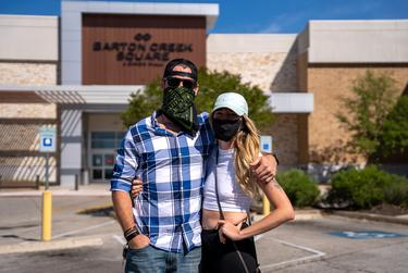 John Whitton and Marina Oneill arrive early to shop at Barton Creek Square Mall on the day some Texas businesses began reopening on a limited basis.