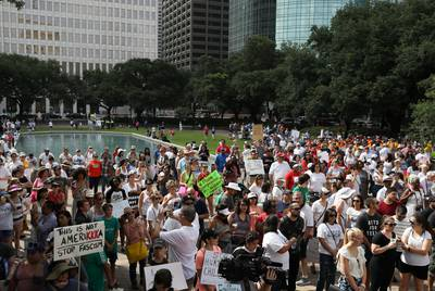 Demonstrators at Herman Square listen to speakers in front of City Hall in Houston.