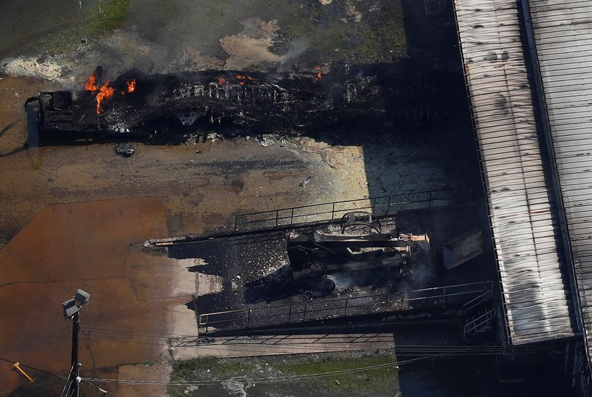 A fire burns at the Arkema chemical plant in Crosby nearly a week after Hurricane Harvey made landfall in Texas. A federal watchdog report found that when the plant burst into flames on Aug. 31, 2017, most government air quality monitors hadn't yet been deployed.