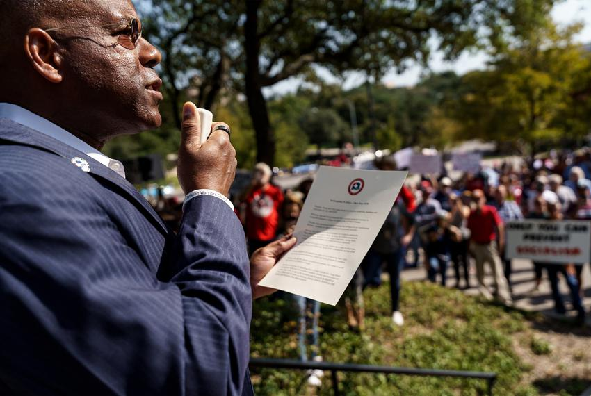 State GOP Chairman Allen West speaks to protestors gathered at the Governor's Mansion to protest Gov. Abbott's executive ord…
