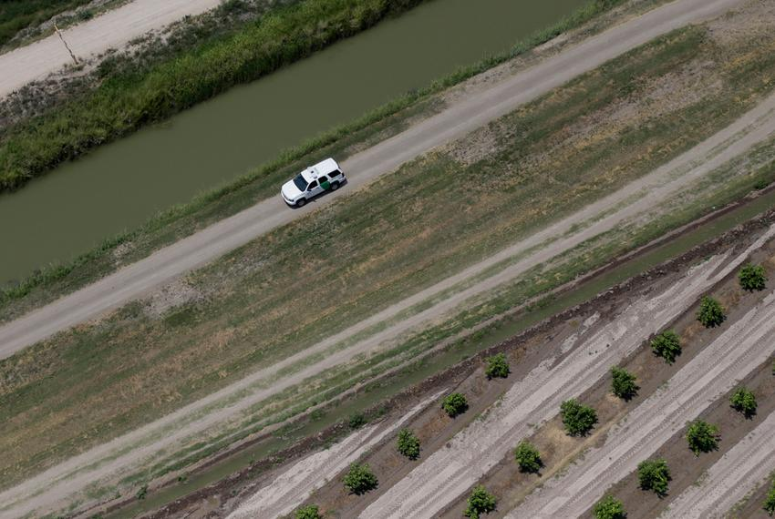 A Customs and Border Protection vehicle patrols on the Texas border near the Rio Grande, Thursday, July 24, 2014, in Mission…