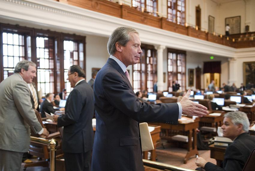 Lt. Gov. David Dewhurst reaches to shake the hand of a member following his visit to the House chamber Thursday afternoon to…