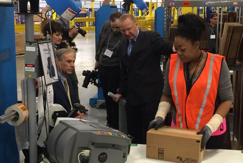 Gov. Greg Abbott tours Amazon's new distribution center Friday outside San Antonio. The hub in Schertz is one of three in ...