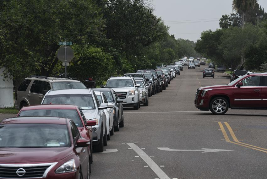 People wait in their vehicles to get tested for COVID-19 at a temporary testing site in Mission on June 26, 2020.