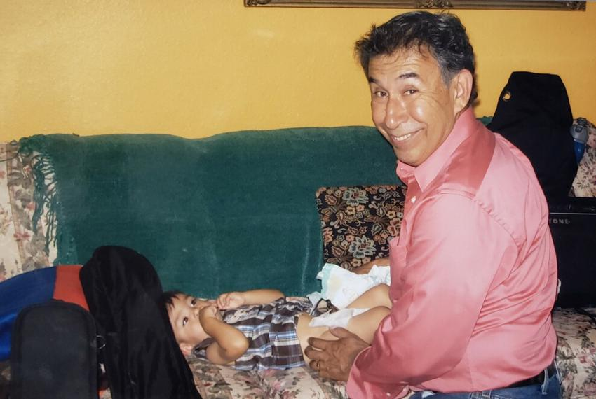 Alvarado with one of his grandchildren, Judah.