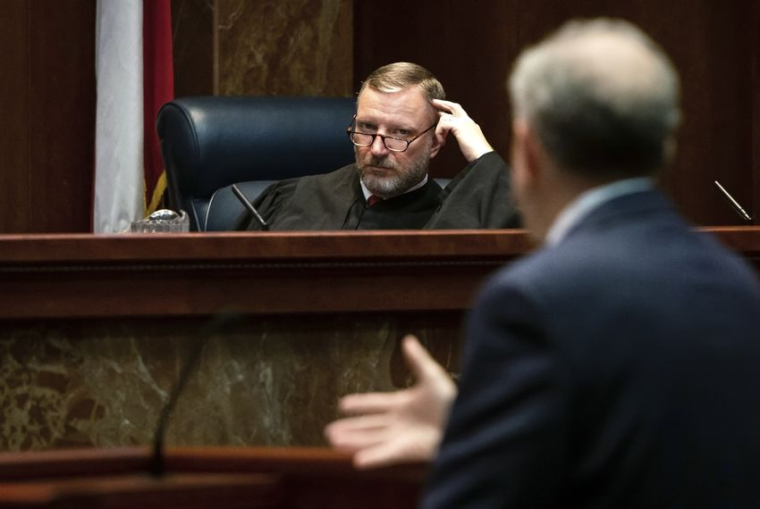 Justice Jeff Brown listens to Philip Durst during the Texas Supreme Court hearing in the case of Texas Department of Criminal Justice v. Maurie Levin, et al.